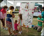 Children paint a square of the grid
